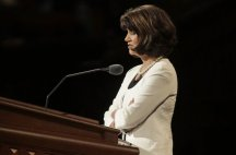 Woman leading closing prayer at General Conference